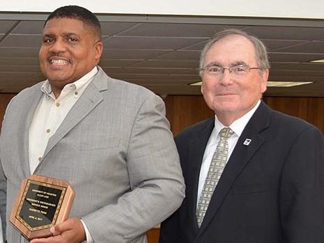Dr. Everette Penn receives University of Houston-Clear Lake President's Award from UHCL President William A. Staples