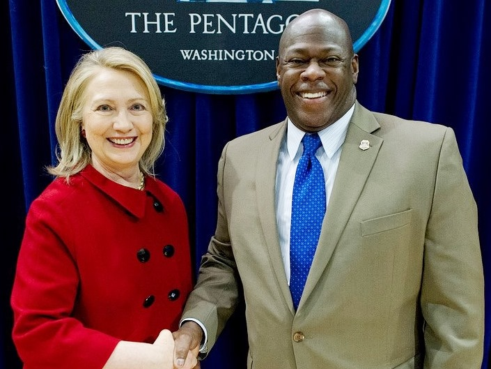 Hillary Rodham Clinton and Carlyle E. Shelton Jr.